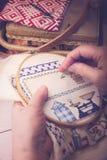 Cross Stitching. A mature lady doing cross stitching Royalty Free Stock Image