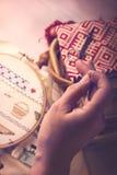 Cross Stitching. A mature lady doing cross stitching Stock Photo