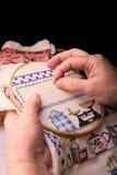 Cross Stitching. A mature lady doing cross stitching Stock Image