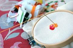 Cross Stitching and Needle. The start of a cross stitching craft Stock Photography