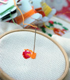 Cross Stitching and Needle. The start of a cross stitching craft Stock Images