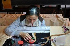 Cross-Stitching Woman Stock Photography