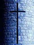 Cross in stone. A cross window of a modern church with stone blocks Royalty Free Stock Images