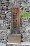 Cross stone carved copy. (Hachkar) next to the Geghard monastery in Armenia royalty free stock image