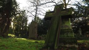 Cross Stone in Christian Cemetery. Video stock video footage