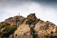 Cross on a stone mountain, Christian symbol Royalty Free Stock Image