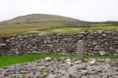 Cross in the stone stock photo