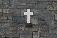 Cross in stone wall Royalty Free Stock Photo