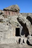 Cross-stones and entrance to monastic cells of Geghard rock mona Stock Photo