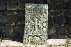 Khachkar or cross-stone. Cross-stones or khachkars at the 9th century Armenian monastery of Sevanavank. Khachkars are carved memorial stele, covered with stock photography