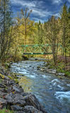 Steel Bridge over Mountain River in Washington. Cascade Mountain River and Bridge on Sunny Spring Afternoon Stock Images