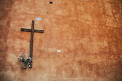 Cross. The streets of Rome. Cross on the wall. The streets of Rome. Sommer Royalty Free Stock Photos