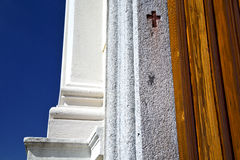 Cross sumirago curch broke brike pattern sunny day    sky Royalty Free Stock Photos
