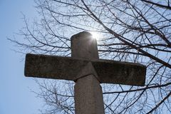 The cross with the sun behind royalty free stock images