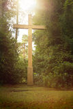 Cross with sunbeams on a meadow Royalty Free Stock Photo