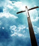 Cross in sunrays Stock Photography