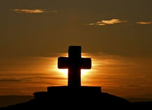Cross at sunset. Beautiful black silhouette cross the beautiful sunset and the light that comes after him in Croatia (Dalmatia). Horizontal color photo stock photos