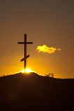Cross on sunset Stock Photography