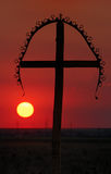 Cross at Sunset. A silhouette of a cross at sunset royalty free stock images