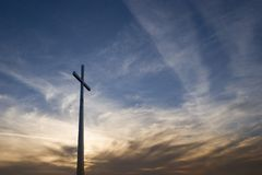 Cross in sunset Royalty Free Stock Photos