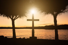 Cross sunset. Cross between two trees at sunset Royalty Free Stock Images