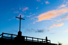 Cross symbol of Christianity. Over the blue sky royalty free stock image
