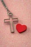 Cross symbol and heart Stock Photo