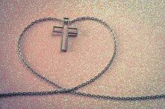Cross symbol in love shape Royalty Free Stock Image