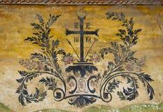 Cross with symbols. Ornaments in monastery wall - Preobrajenski monastery near by Veliko Tarnovo Stock Images