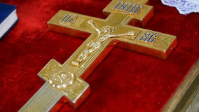 Cross on the table of the priest.  stock video