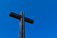 Cross. Taken looking up at a blue sky background Royalty Free Stock Photos