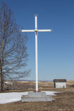 Cross. Tall white cross under a clear blue sky Stock Photography