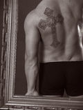 Cross tattoo Stock Photo