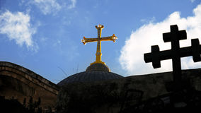 Cross on Temple of the Holy Sepulcher in Jerusalem royalty free stock photo