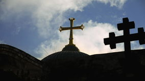 Cross on temple of the Holy Sepulcher in Jerusalem stock footage