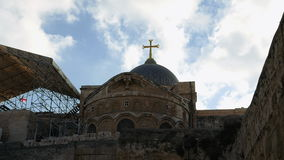 Cross on Temple of the Holy Sepulcher in Jerusalem stock video footage