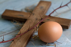 Cross thorn and easter egg abstract symbols. Closeup Royalty Free Stock Photos