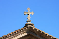 Cross on tiled roof Royalty Free Stock Images