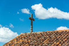 Cross and Tiled Roof Stock Photo