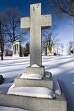 Cross Tomb Stone. A cross shaped tomb stone in a cemetary in ohio during the winter stock images