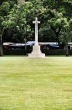 Cross on tombstone in cemetery. Stock Photography