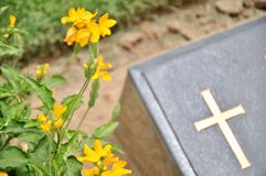 Cross on tombstone in cemetery. Royalty Free Stock Photos