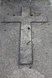 Cross in a tombstone Royalty Free Stock Photography