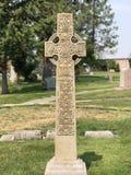 Cross tombstone stock photos