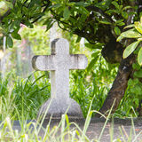 Cross on tombstone Stock Photo