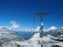 Cross on top of the Alpine Stock Photos