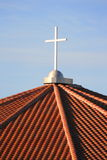 Cross On Top Of A Church. Over blue sky Royalty Free Stock Images