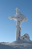 A cross on top covered with ice. Royalty Free Stock Photography
