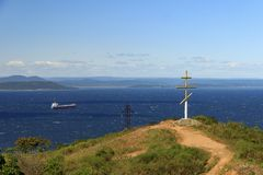 A cross at the top of the Eagle`s Nest hill in the center of Vladivostok