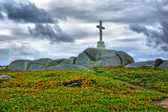 Cross on top of the granite rocks Royalty Free Stock Image